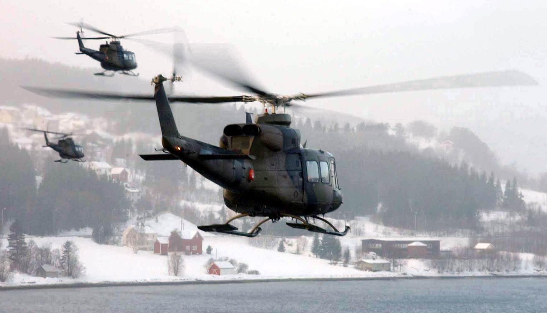 LUNDAMO, Norway -- A group of Norwegian Bell 412SP's travel to the port of Orkanger to insert a team of Marines from 1st Battalion, 8th Marine Regiment. The leathernecks are participating in DV (distinguished visitors) Day March 10 during Battle Griffin, the second phase of NATO exercise Strong Resolve '02. (USMC photo by Cpl. Paula M. Fitzgerald)